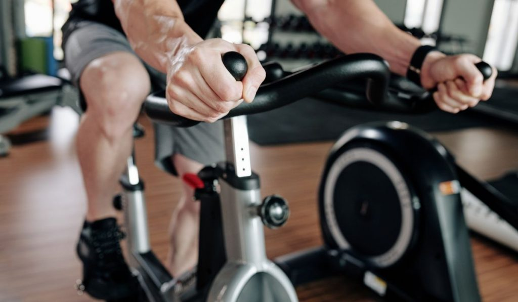 man exercising on the stationary bike