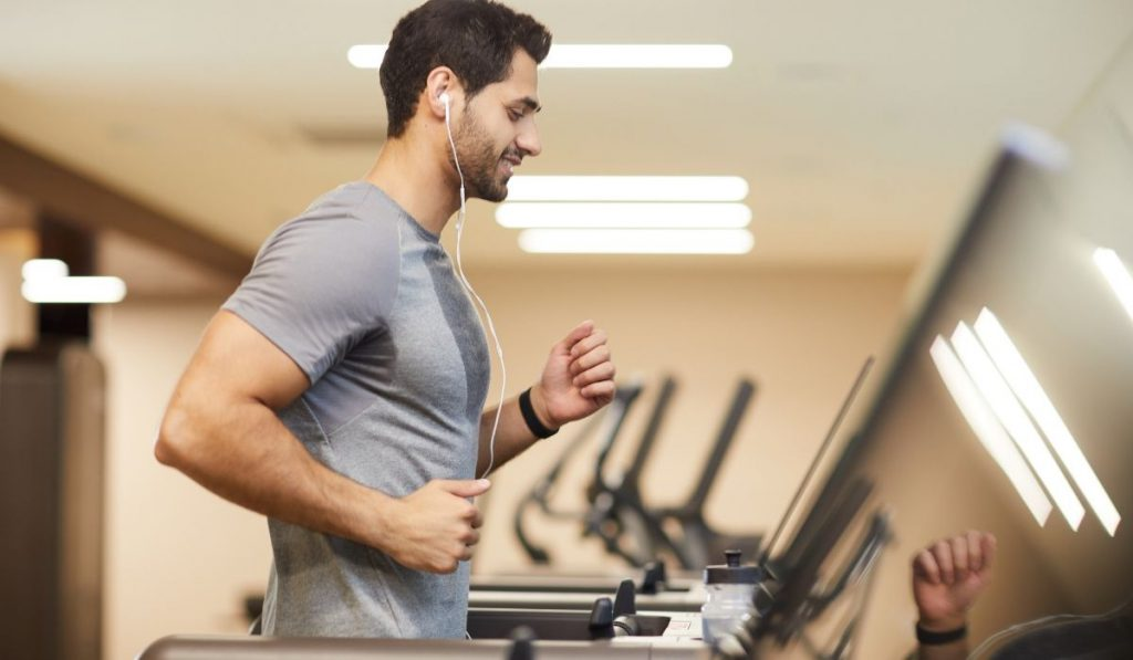 man exercising on threadmill