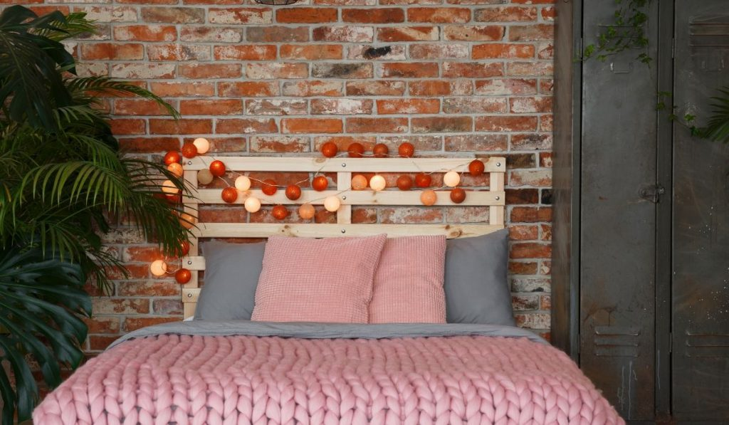 pink bedding with throw pillows