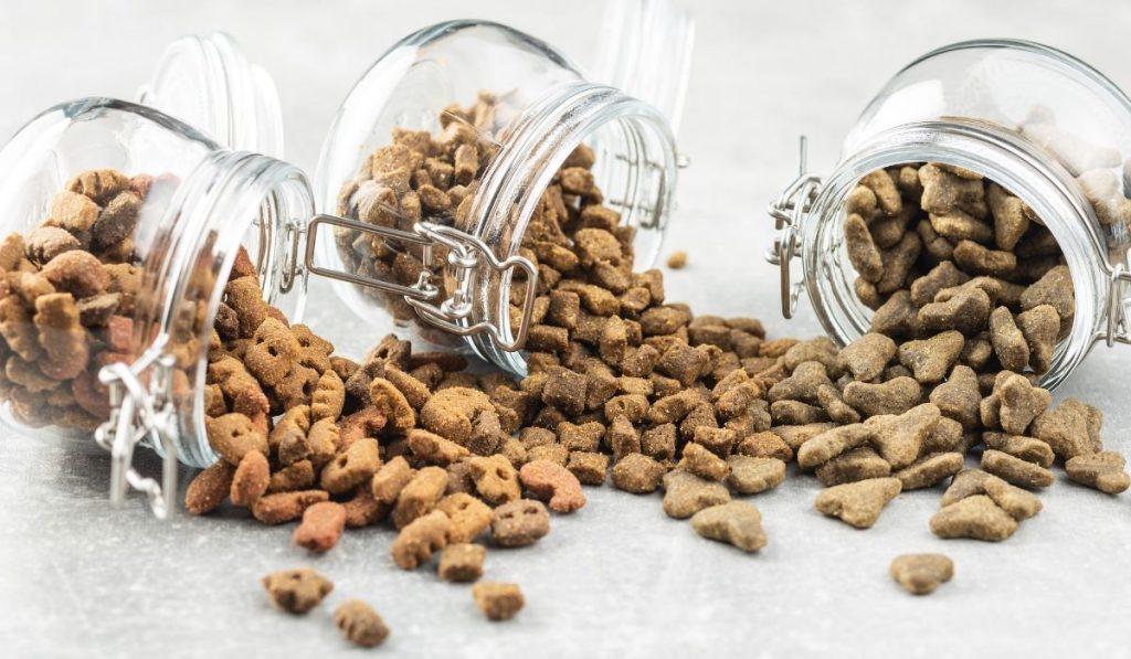 spilled dog food from 3 jars