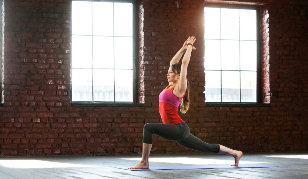 woman doing yoga in an empty space