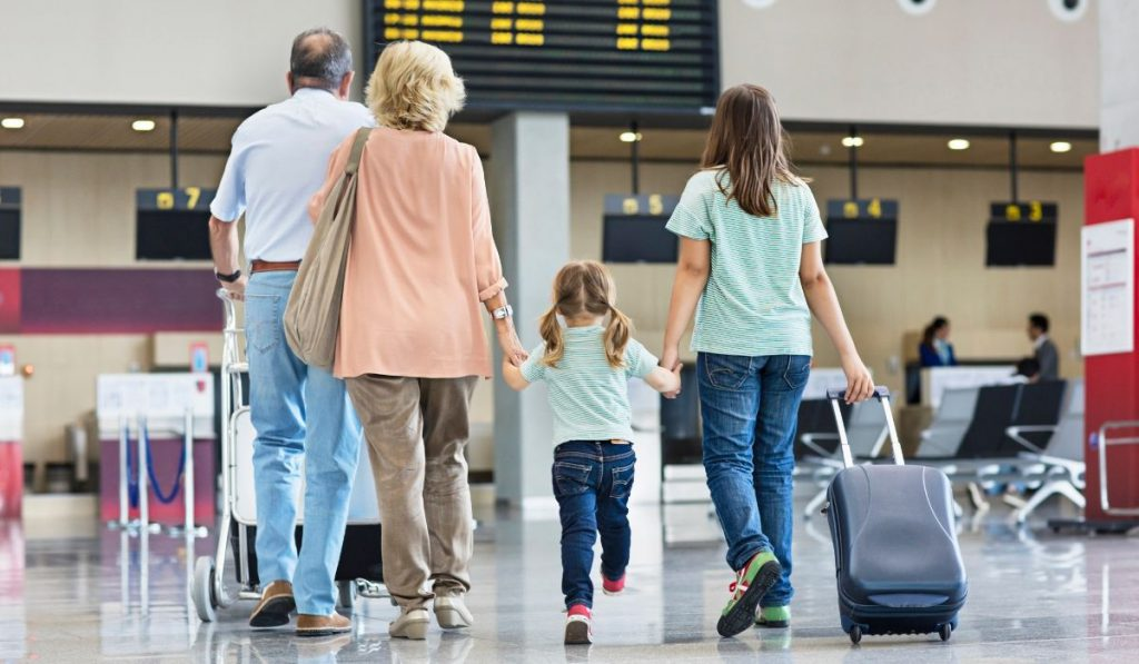 grandparents with their grandkids at the airport