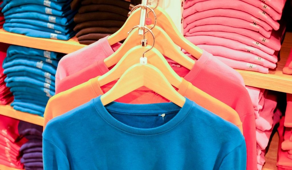 t-shirts on the rack that is stored in a storage facility